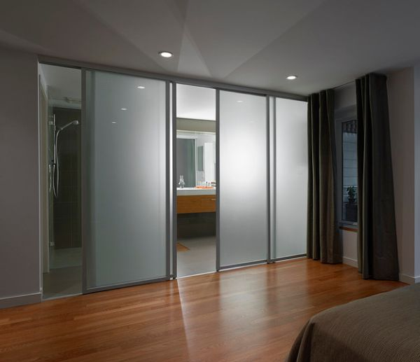 doors frosted glass sliding doors separate the contemporary bedroom