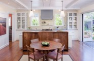 Sparkling Kitchen Cabinet Designs With Glass Doors : Glass Shelves On Either Side Bring Symmetry To This Kitchen In White