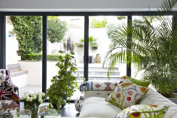 Modern Victorian Home Combining The Past And The Modern Era: Glass Sliding Door White Sofa Green Cushions Green Floral Cushions Glass Table ~ stevenwardhair.com Country Home Design Inspiration