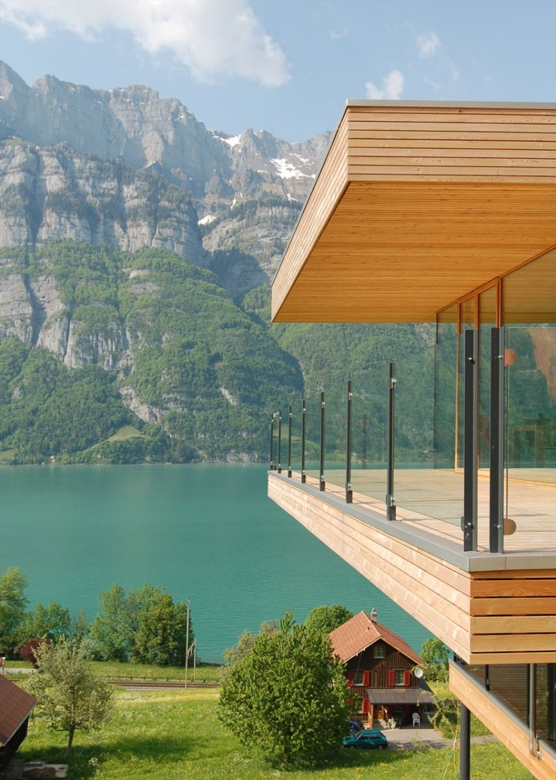 Extraordinary Minimalist Wood House Around Natural Environment: Glazed Wall In Home With Mountain Background
