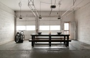 Mesmerizing Motorcycle Display For Gorgeous Decoration Concept : Gorgeous Dream Motorcycle Garage Industrial Style With Darkwood Table And Bench