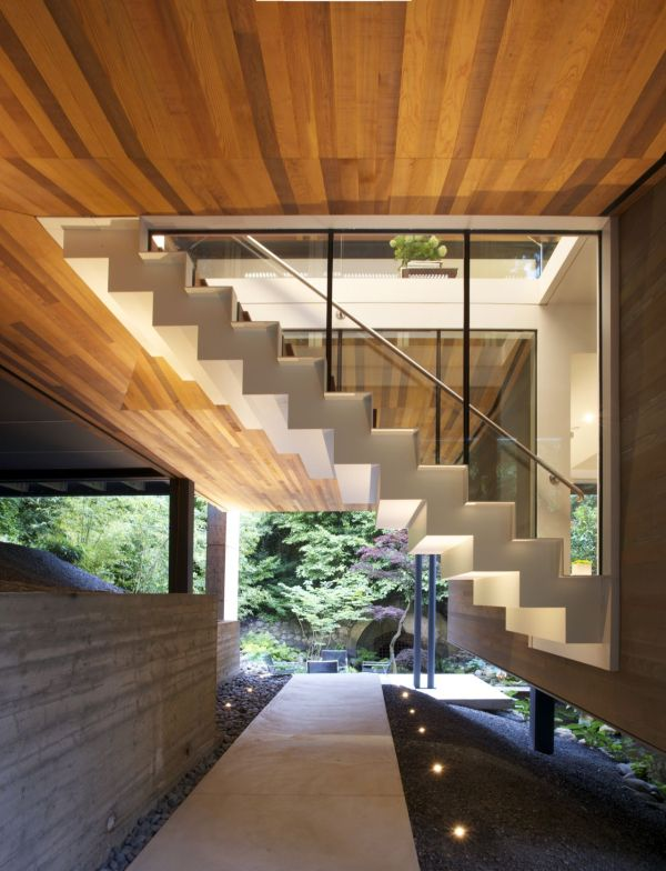 Modern Natural House With The Natural Color: Gorgeous Staircase Leads To The Top Level With Concrete Material Used Glass Fence Design