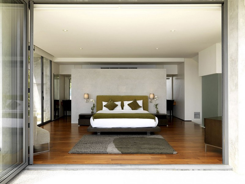 Fantastic Contemporary Villa Design Offers Classy Facilities: Green And White Bed Between Black Table With White Orchid
