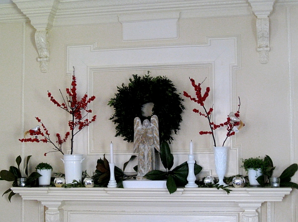 Amazing Fireplace Mantels For Your Best Christmas Ever: Green Boxwood And Magnolia Leaves Are Coupled With Beautiful Red Berries Here ~ stevenwardhair.com Fireplace Inspiration