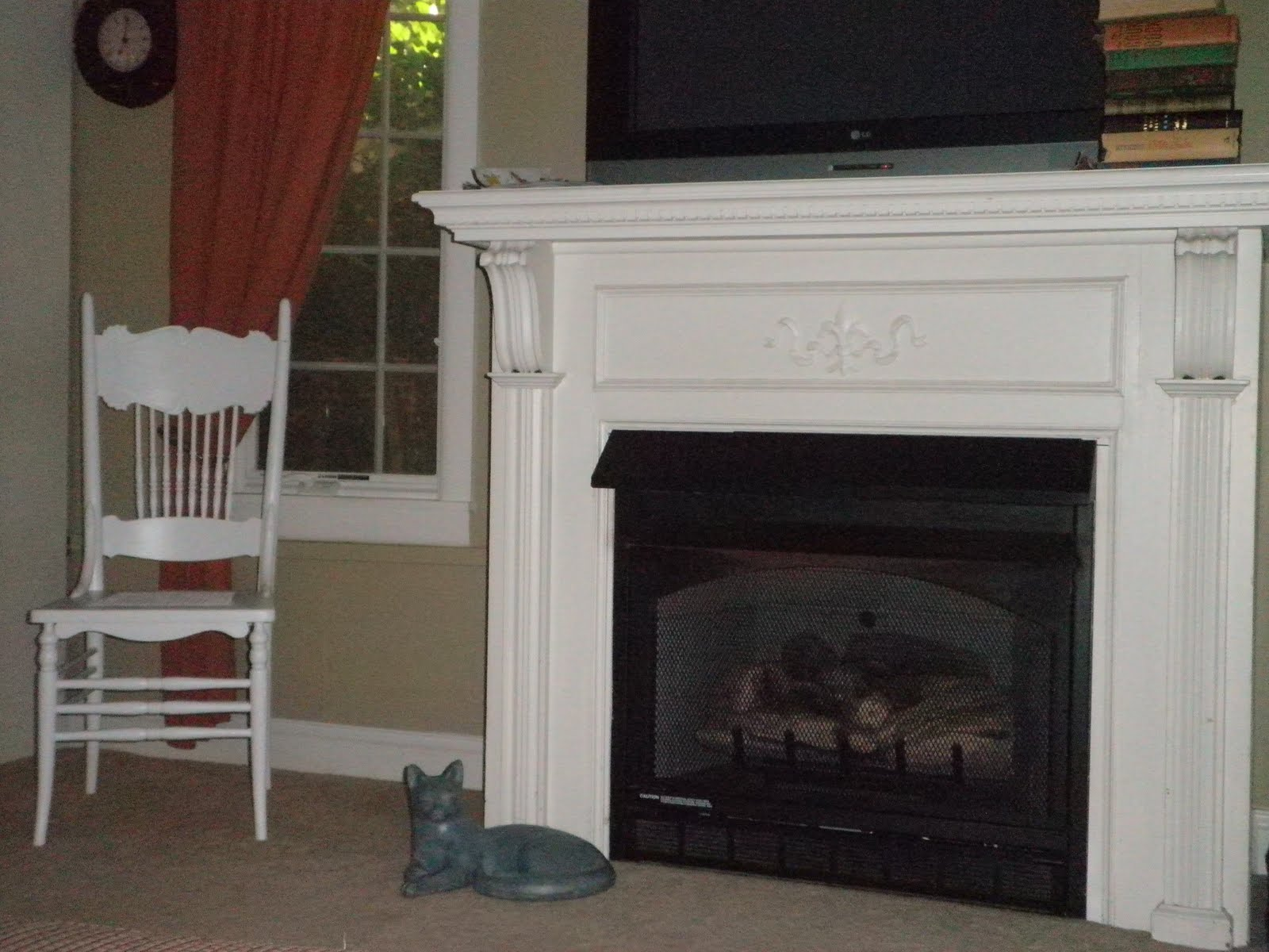 Fireplace Mantel Kits Ideas : He Antique Mantel Fronts A Gas Fireplace