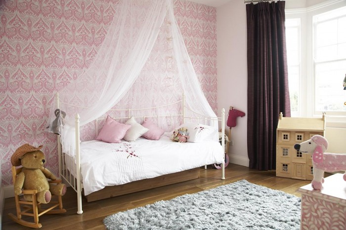 Modern Victorian Home Combining The Past And The Modern Era : Lacy Pink Wallpaper White Mosquito Net Grey Rug White Bed Frame