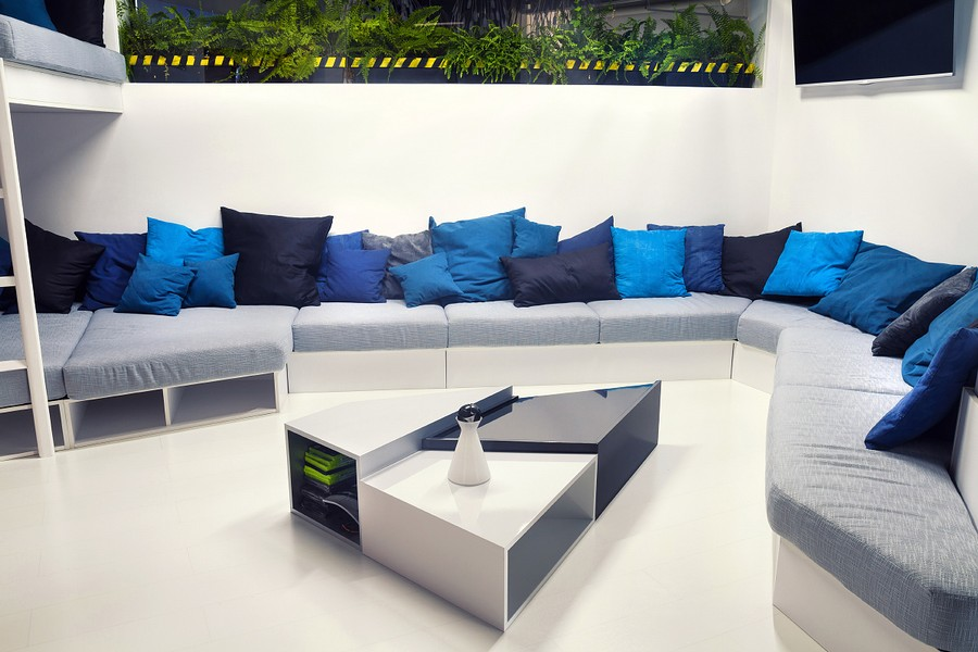 Wonderful Modern Office Design With White Pipes Exposed : Large Couch With Throw  Pillows In Blue