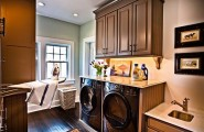 Wonderful Laundry Room With Smart Arrangement To Create Compact Environment : Laundry Room With Fold Down Ironing Board Folding Top Washer Dryer Built In Wood Floors Laundry Sink Marble Tops Bead Board