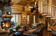 Pleasant Snow Cabin That Gives Warmth In The Midst Of Cold Winter : Log Cabin Style Decor Idea With Leather Sofa And Stone Fireplace