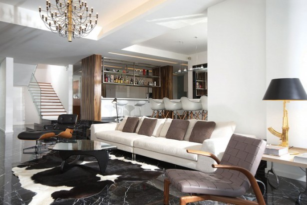 Long White Sofa In The Haillside Residence Sitting Space With Dark Table And Animal Skin Rug