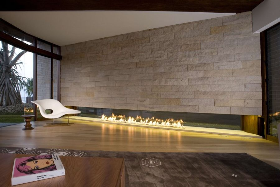 Dramatic Home Applied In Luxurious And Elegant Impression: Luxury Modern Stone Fireplace And Eames Chaise At Albatross House