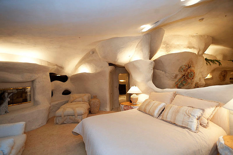 Attractive Prehistoric Stone House Transformed Into Modern Style : Main And Single White Bed With Striped Brown Pillows In Bedroom