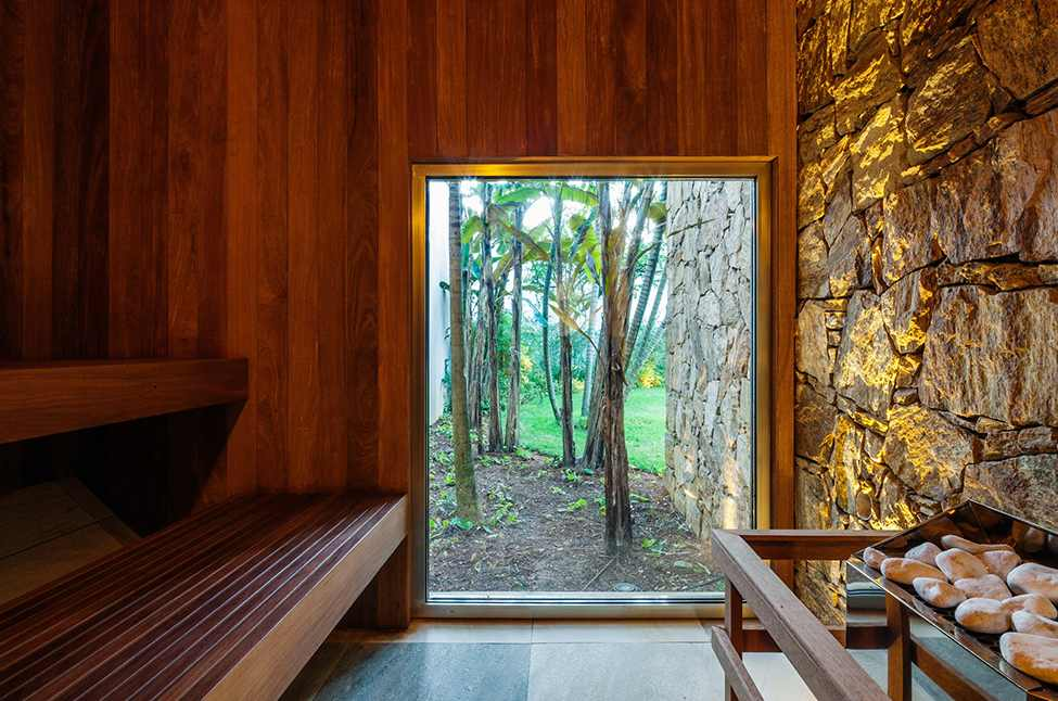 Luxurious Modern Home Design; Four Leveled House: Natural Sauna Room With Wooden Wall Stone Wall And Glass Window