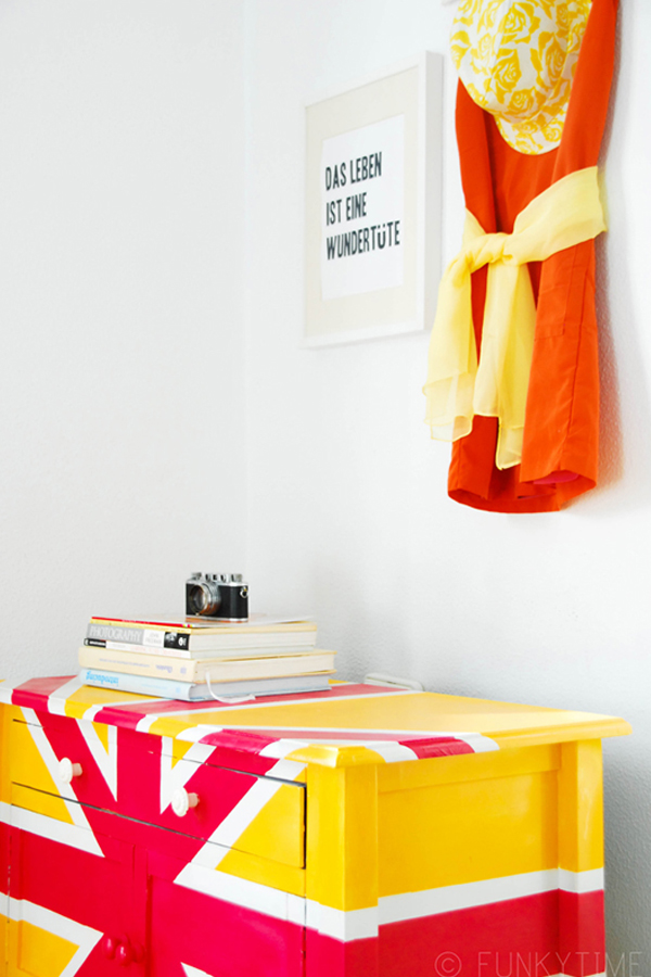 Fabulous Diy Decor Inspirations You Can Do By Yourself: Pink And Yellow Union Jack Cupboard Design With Stacked Books