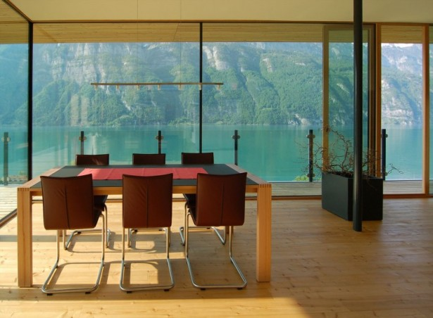 Extraordinary Minimalist Wood House Around Natural Environment: Red Chairs And Wooden Table With Red Table Cloth Overlooking Outside View Through Glazed Wall ~ stevenwardhair.com Minimalist Home Design Inspiration