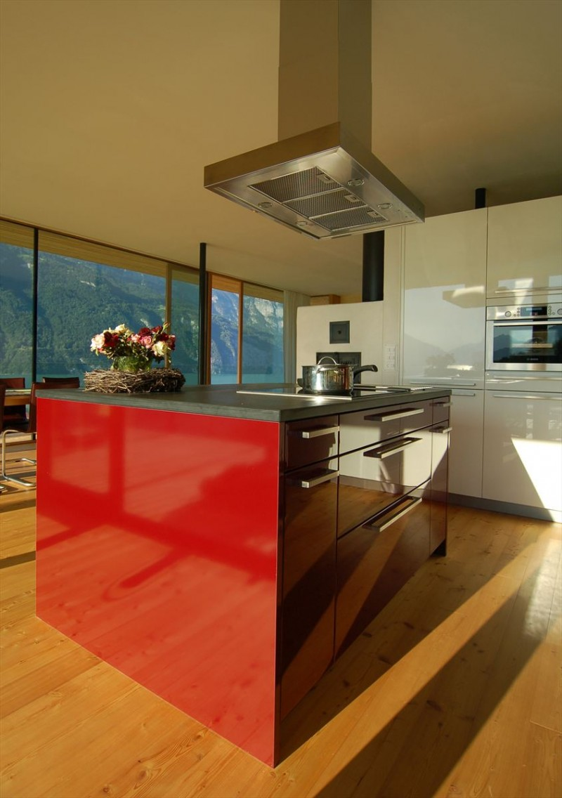 Extraordinary Minimalist Wood House Around Natural Environment : Red Kitchen Table With Grey Surface Completed With Beautiful Flowers On It