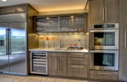 Sparkling Kitchen Cabinet Designs With Glass Doors : Reeded Glass Cabinet In The Center Offers Textural Contrast In This Kitchen Space