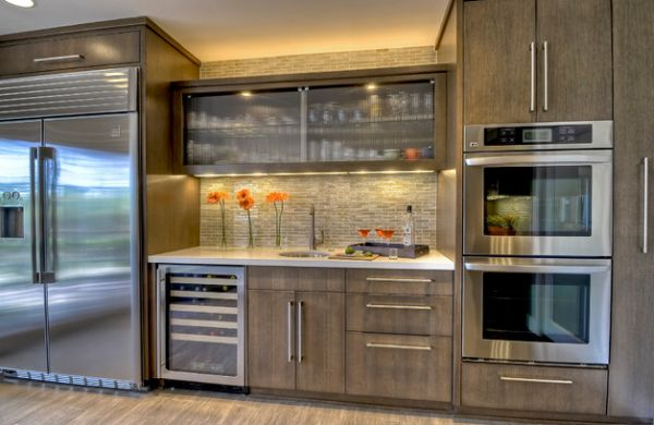 Sparkling Kitchen Cabinet Designs With Glass Doors: Reeded Glass Cabinet In The Center Offers Textural Contrast In This Kitchen Space