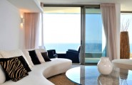 Stylish Sliding Glass Door Designs: 40 Modern Images : Rich Interiors Sport A Curved Sofa And Beautiful Drapes