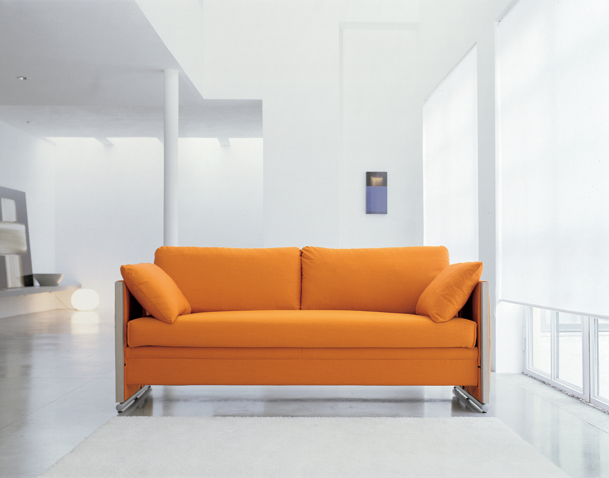Orange Sofa As Cheerful Furniture: Simple Modern Orange Sofa Chrome Accents Clean White Interior
