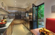 Warmth Homey Apartment In The Big Apple : Sleek Modern Kitchen Glossy Cupboard New York Home For Sale