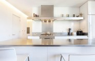 Contemporary Apartment Design In Iconic New York Area : Sleek Modern Kitchen In SoHo New York Apartment With Grey Countertop