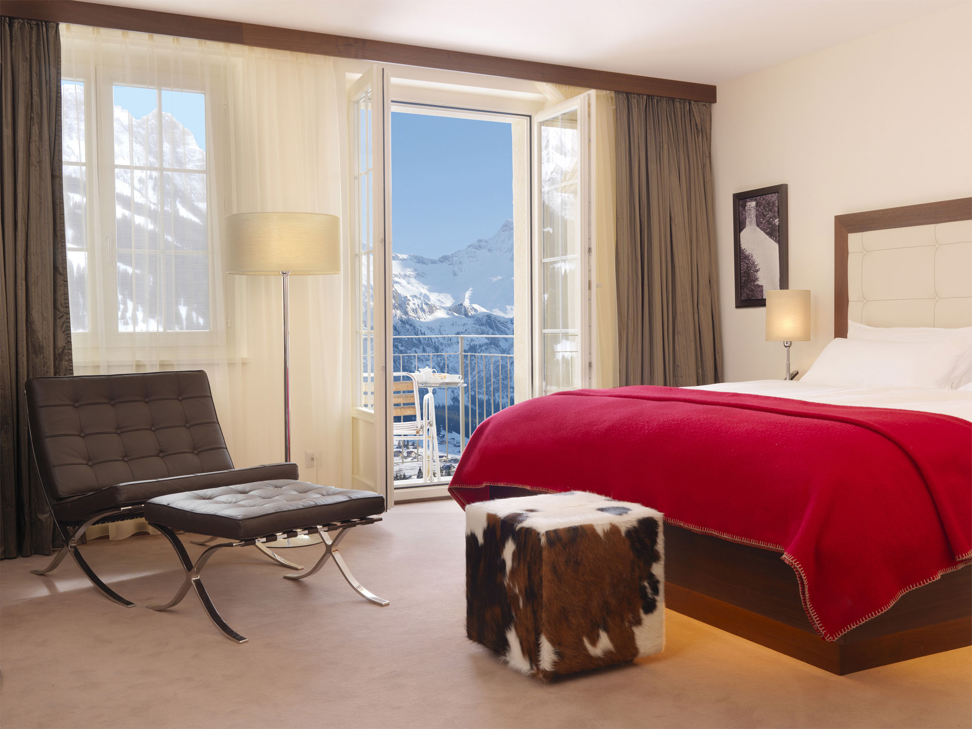 Mesmerizing And Luxurious Hotel With Interior Design That Have Mountain View : Small Pouffe With Black Chairs Near White Bed