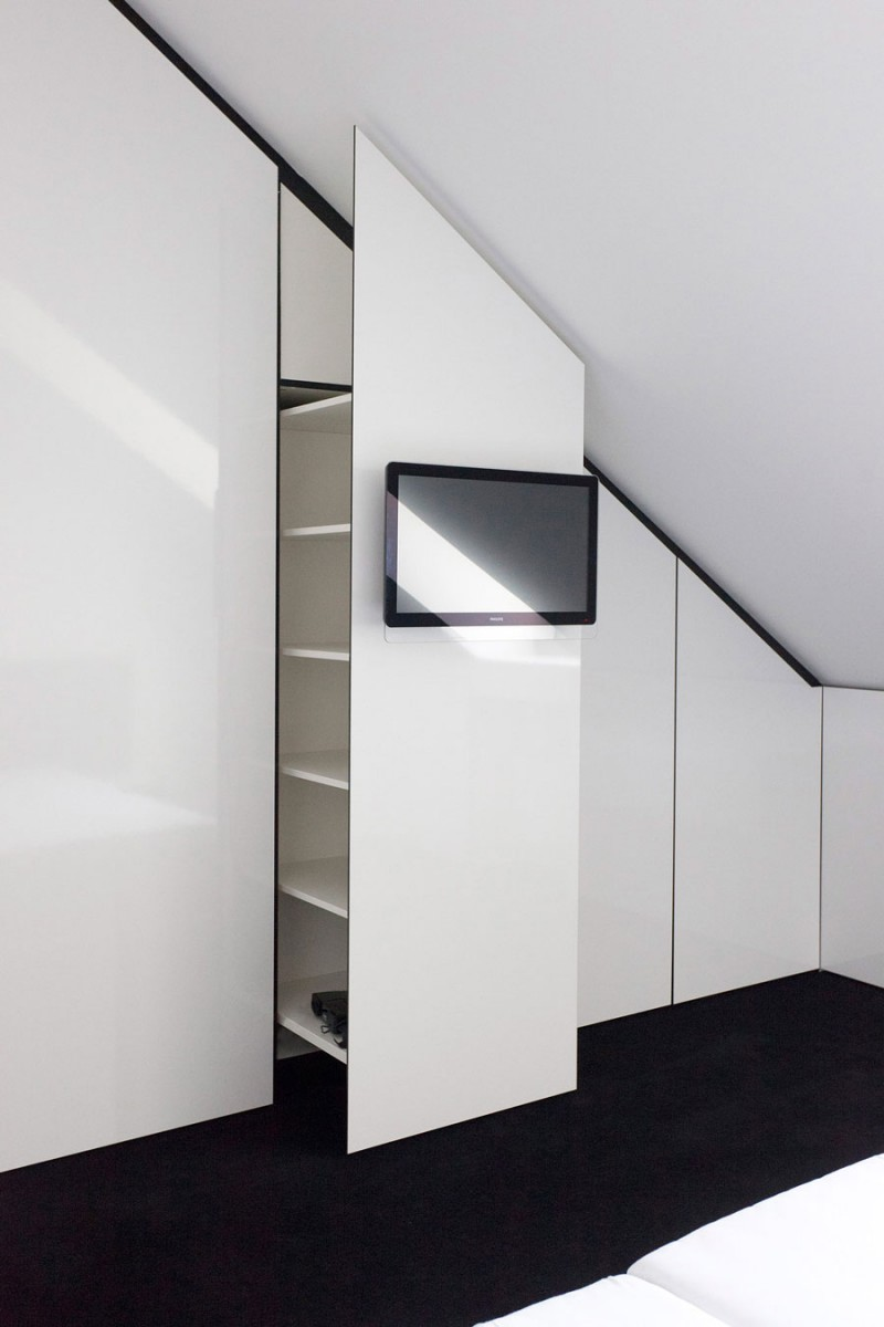 Monochrome Modern Apartment With Round Edge: Smart Lifting Up The Cabinet Idea Installed Inside White And Black Themed Nic Nlab House Master Bedroom With TV