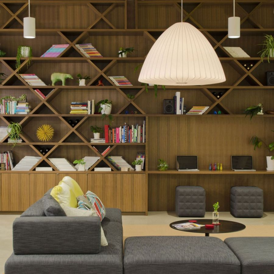 Remarkable Open Office Design Of Portland Based Firm : Smart Shelves And Lighting In The Modern Office Grey Fabric Couch