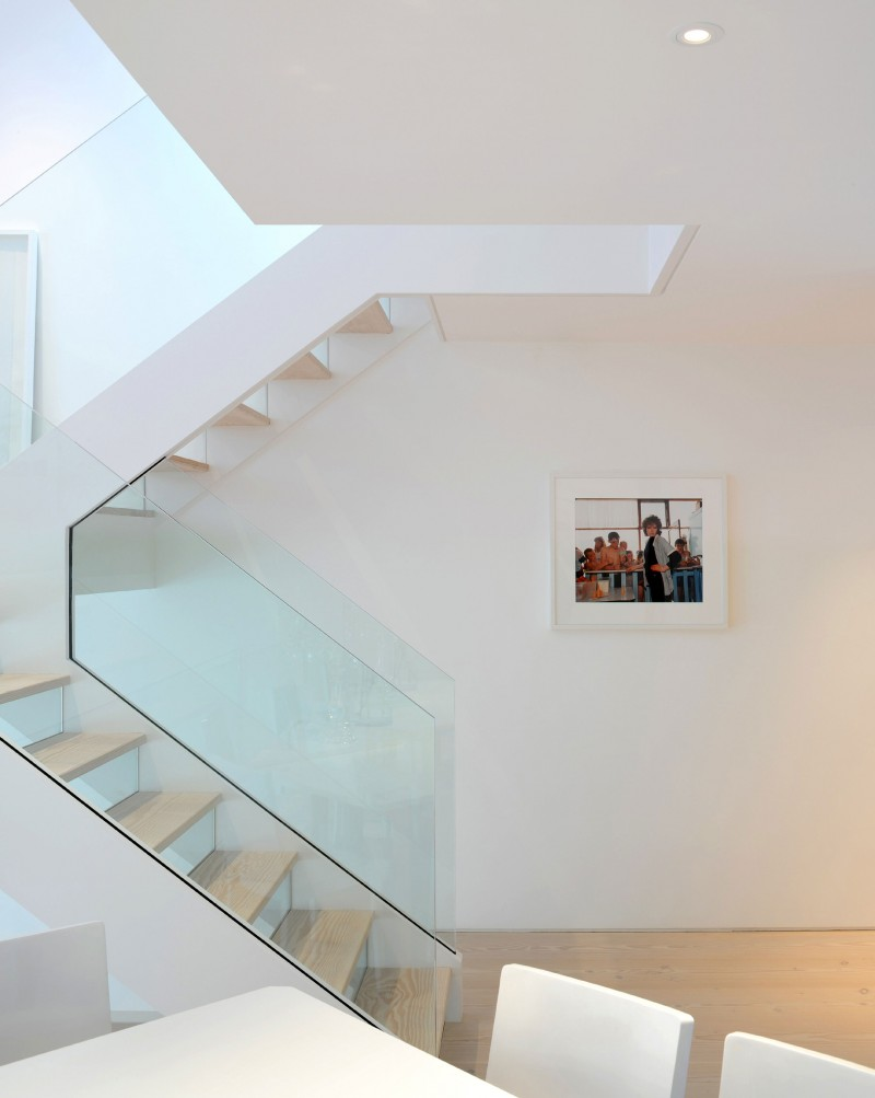 Simple White Interior Bring Calm Nuance To Your House: Staircase With Glass Railing Makes An Important Addition To The Highgate Home