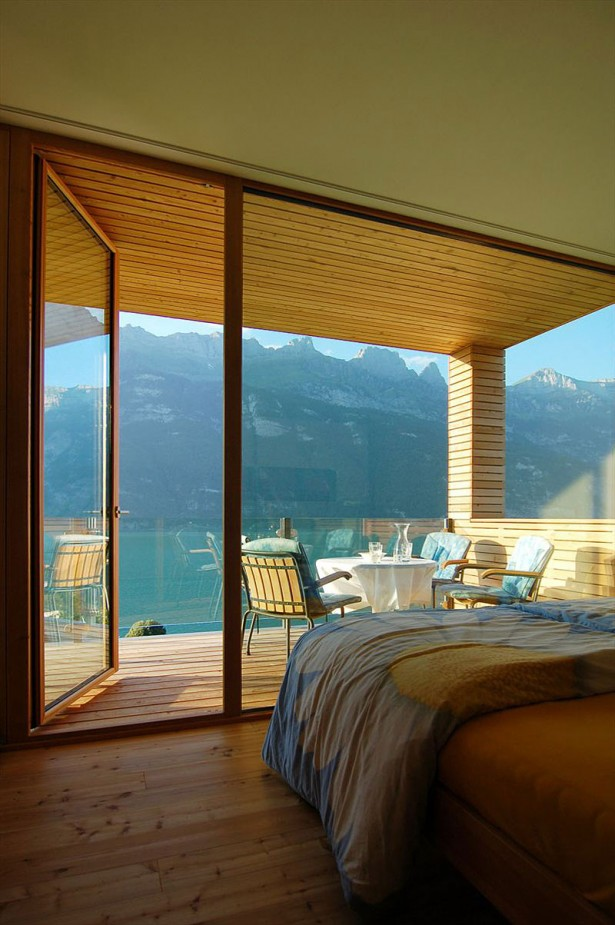 Extraordinary Minimalist Wood House Around Natural Environment: Sun Flower Motif Blanket In Yellow Bed Overlooking Mountain View ~ stevenwardhair.com Minimalist Home Design Inspiration