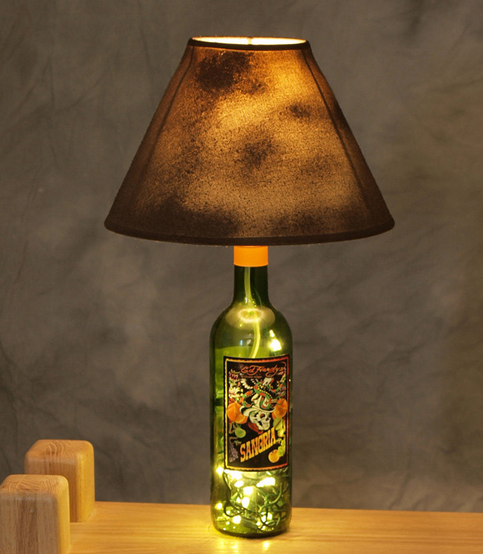 Sparkling Wine Bottle In Eco Friendly Theme For Recycling: Unique Details In The Wine Bottle As Table Lamp With Brown Shade And Bright Lighting On Wooden Table