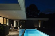 Stunning Modern Home Interior With Black And White : Verandah Equiped With Glazed Fences Near The Blue Swimming Pol