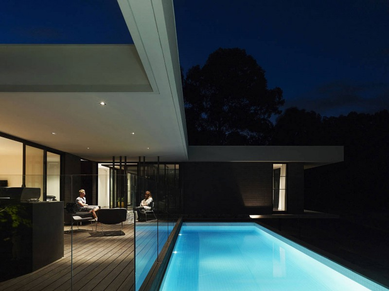 Stunning Modern Home Interior With Black And White: Verandah Equiped With Glazed Fences Near The Blue Swimming Pol