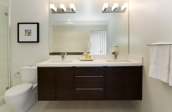 Bathroom Vanity; Personal Taste In Your Bath Room: White Countertop And Dark Cabinetry Make This Bathroom Vanity Stylish And Beautiful ~ stevenwardhair.com Bathroom Design Inspiration