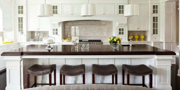Doing Up Your Kitchen With Astounding Hanging Pendant Lights: 55 Inspiring Images : White Kitchen With A Large Island And Dark Contrasting Countertop