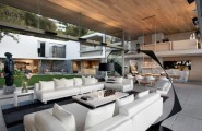 Enchanting Modern House With Maximum Use Of Natural Feelings : White Sofa Spacious Modern Coastal House Interior Living Space