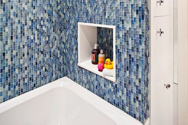 Wonderful Bathroom Decoration In Luxury Loft With Blue Colored Wall Made From Ceramic Blocks And Several Animals Dolls