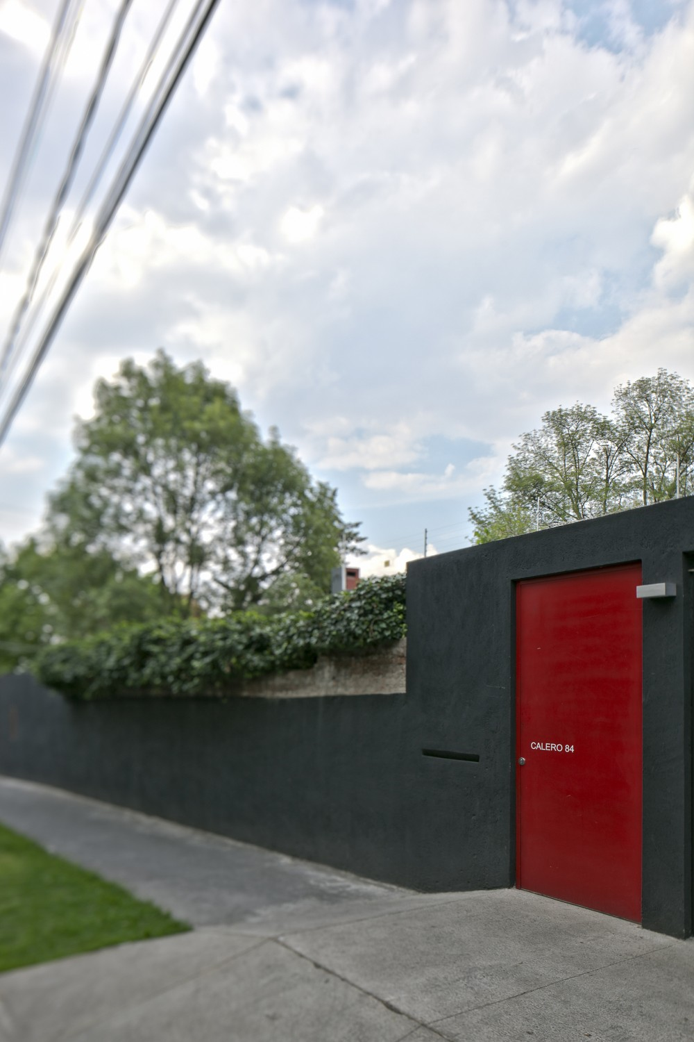 Beautiful Touch Of Decor In Modern Residence: Wonderful Exterior Calero House With Grey Wall Decoration And Red Door