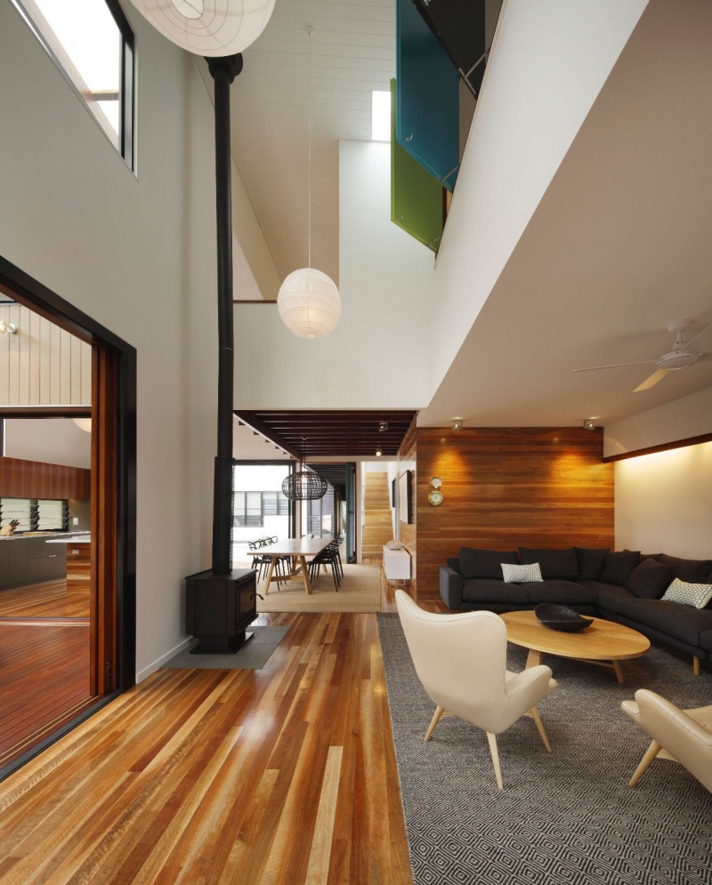 Stylish colorful theme idea for cheerful atmosphere wood plank flooring iddea with double height ceiling