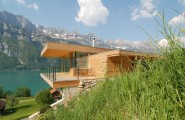 Extraordinary Minimalist Wood House Around Natural Environment : Wooden Home With Balcony Viewed From Front Yard