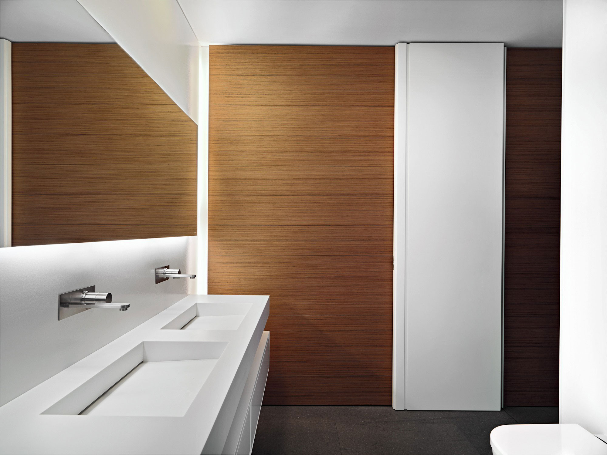 Victor Vasilev Simple And Minimalist White Residence Interior Design: Wooden Wall Paneling Among White Wall In Bathroom