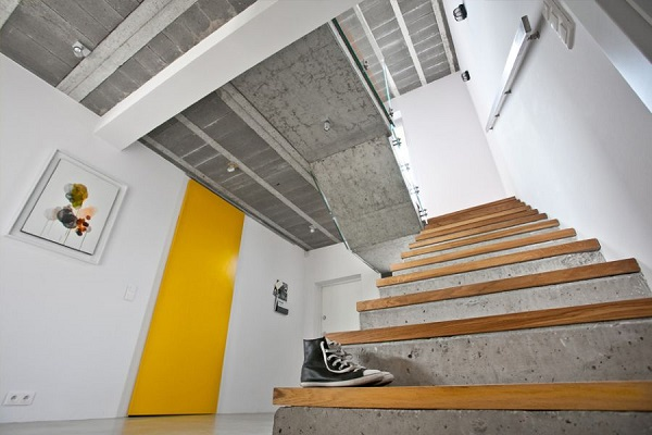 Yellow Accent Door Inside The House With Concrete Staircase Design2